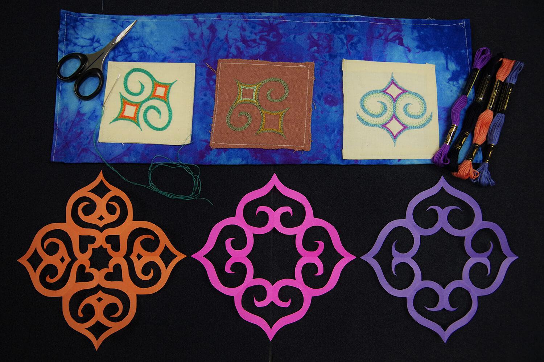刺繍体験の見本(上)と切り紙体験の見本(下)。アイヌ文様の下絵をなぞるように作成します